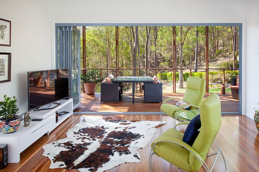 Twin chairs, cowhide rug and sleek TV stand in the breezy living room