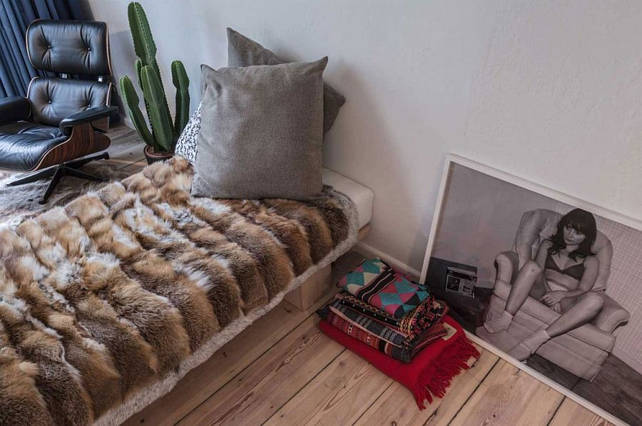 Unassuming bed and Eames Lounger in the bedroom