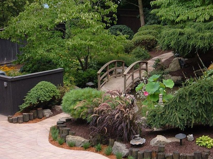 Use the garden bridge to bring intrigue and elegance to the landscape around your home [Design: Esposito Landscaping]