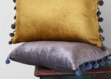 Velvet-pom-pom-pillows-from-Urban-Outfitters-217x155