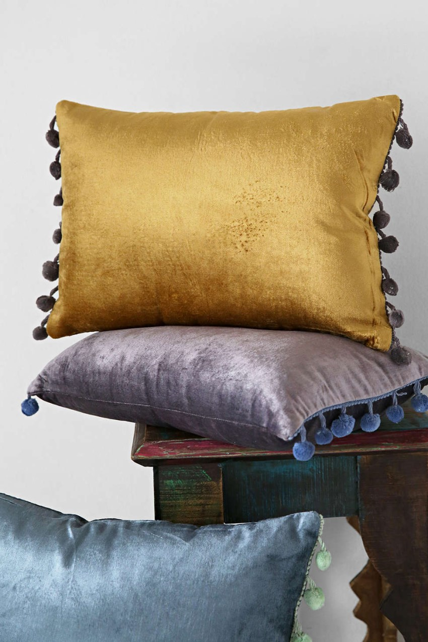 Velvet pom pom pillows from Urban Outfitters