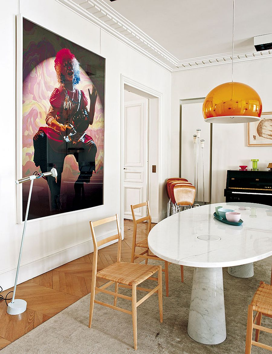 Wall art and pendant lighting bring color to the dining room