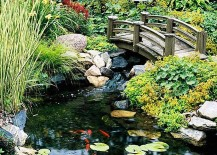 Water garden landscaping idea with a beautiful bridge [From BHG]