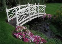 White-garden-bridge-across-natural-backyard-stream-217x155