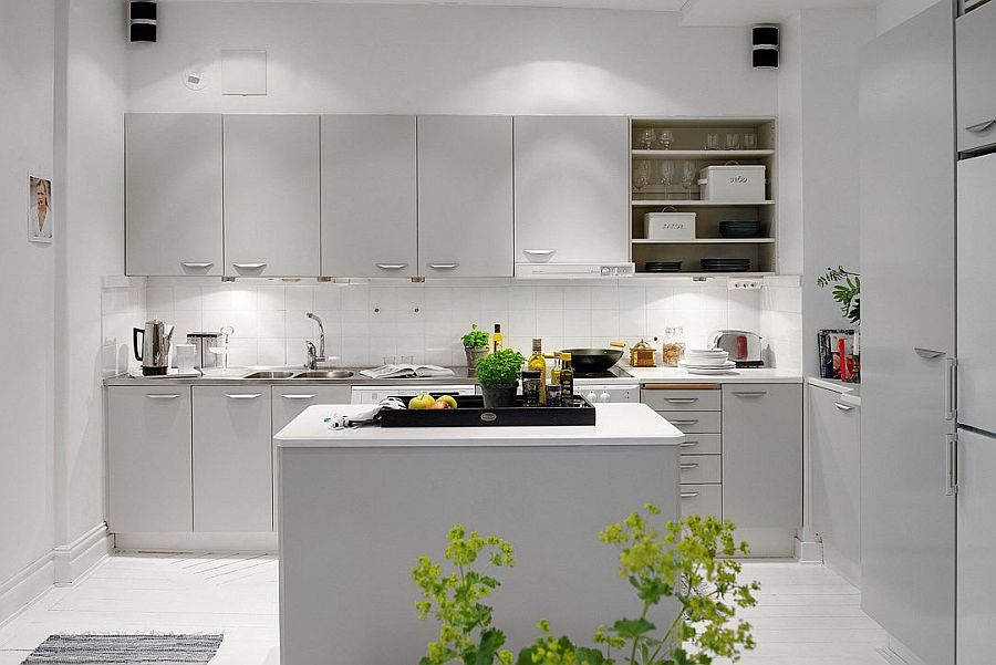 White subway tiles create a cool backsplash in the kitchen