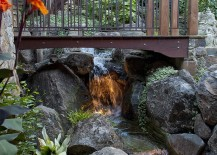 Wooden-bridge-over-the-waterfalls-with-beautiful-lighting-217x155