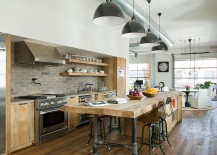 Wooden island and lighting give this kitchen the industrial touch [Design: SUBU Design Architecture]