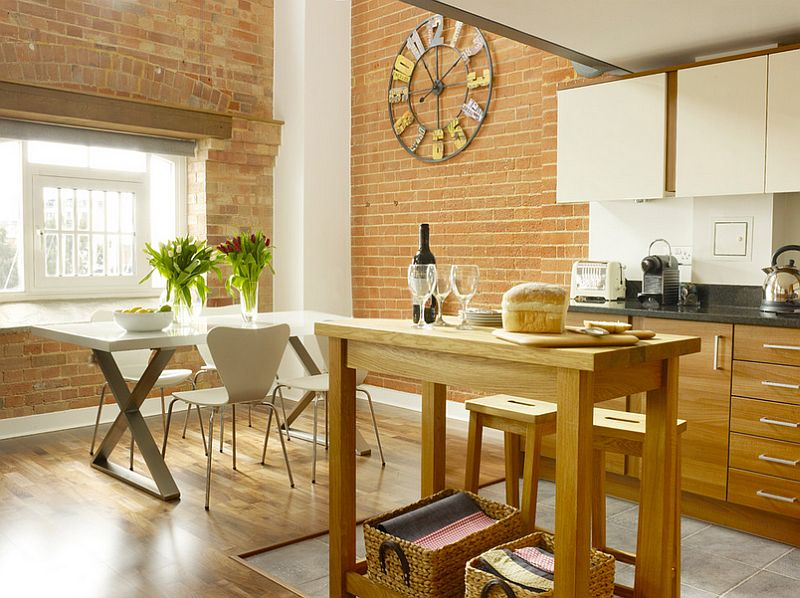 Wooden surfaces in the kitchen complement the smart brick backdrop perfectly [Design: Rendall & Wright]