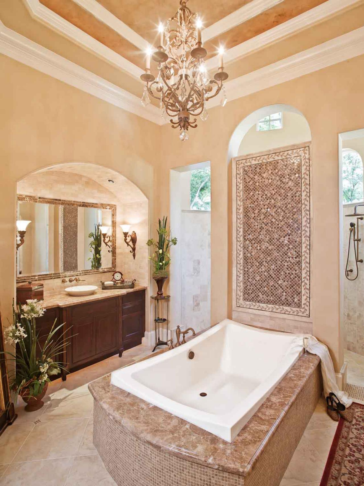 20 luxurious bathrooms with elegant chandelier lighting for Elegant master bathroom ideas