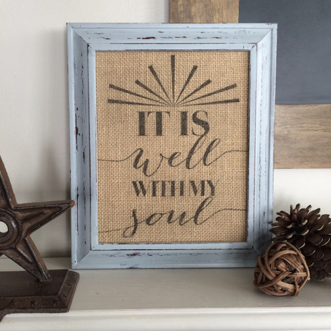 Framed burlap with quote displayed on furniture