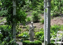 Classic garden design with archway and statue