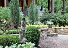Garden statues next to the garden pathway are a classic look