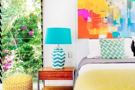 Adding art work to the bedroom walls is all about getting the color scheme right