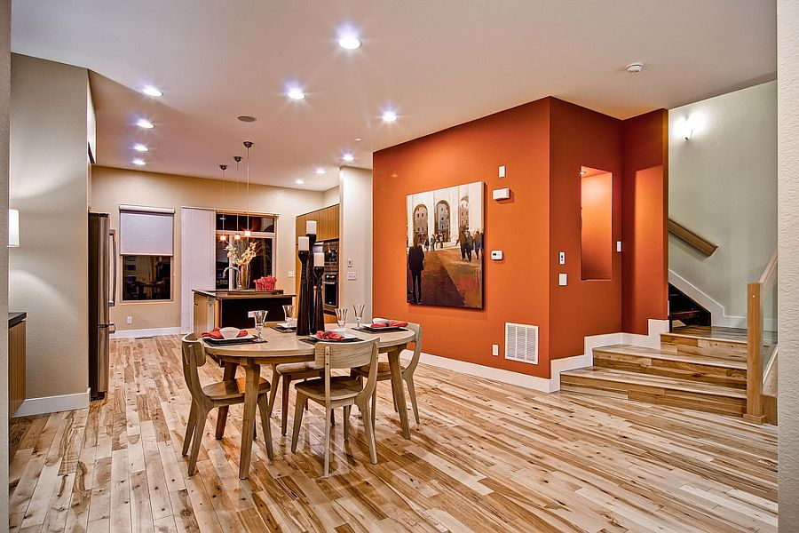 An orange backdrop for contemporary dining space in open plan living area [Design: Wonderland Homes]