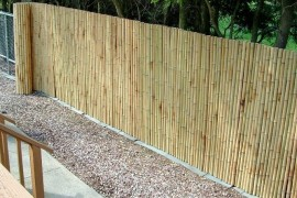 Bamboo fencing adds privacy to chain link privacy fence Modern Privacy Fence Ideas for Your Outdoor Space Bamboo fencing adds privacy to chain link 270x180