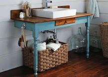 Vintage desk in blue turned into bathroom vanity