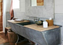 DIY bathroom vanity crafted from old  horse trough