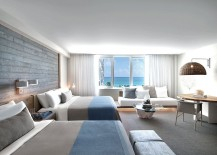 Beach style interiors of the room complement the setting outside