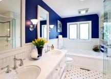 Beadboard paneling in a cobalt blue bathroom