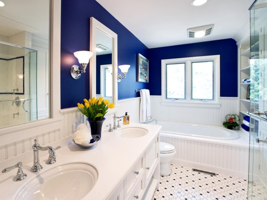 Beadboard paneling in a cobalt blue bathroom