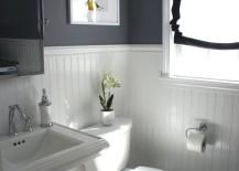 Beadboard paneling in a grey bathroom
