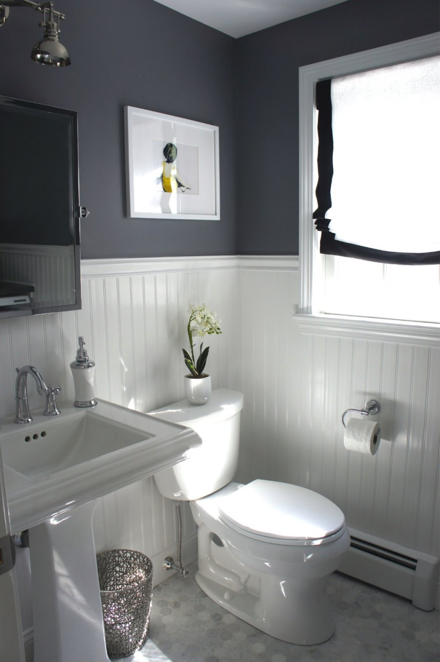 Beadboard paneling in a grey bathroom