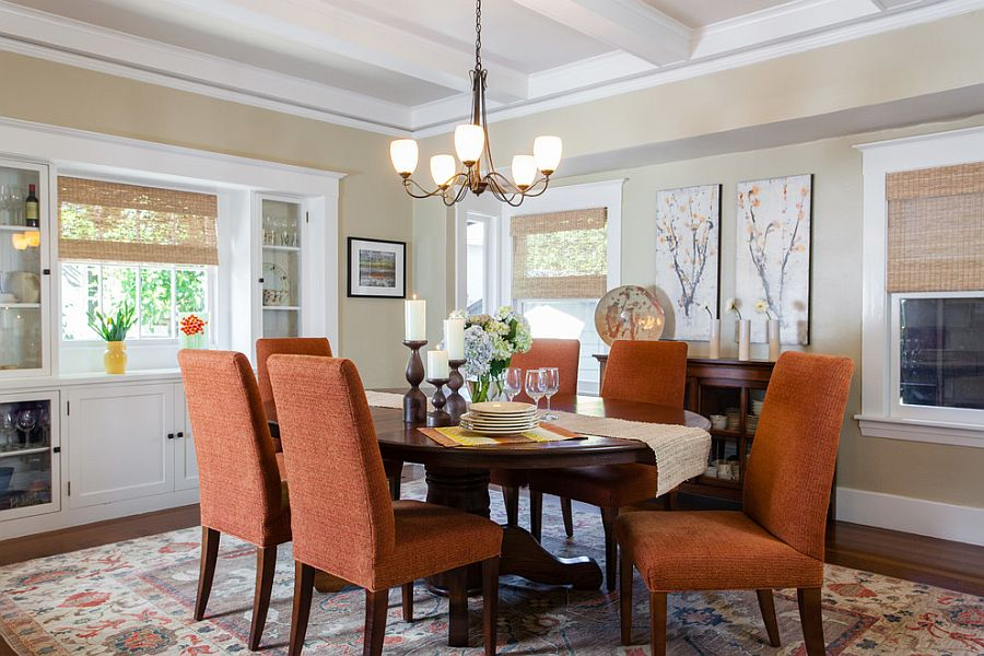 Beautiful orange chairs bring color to the traditional dining room [Design: AND Interior Design Studio]