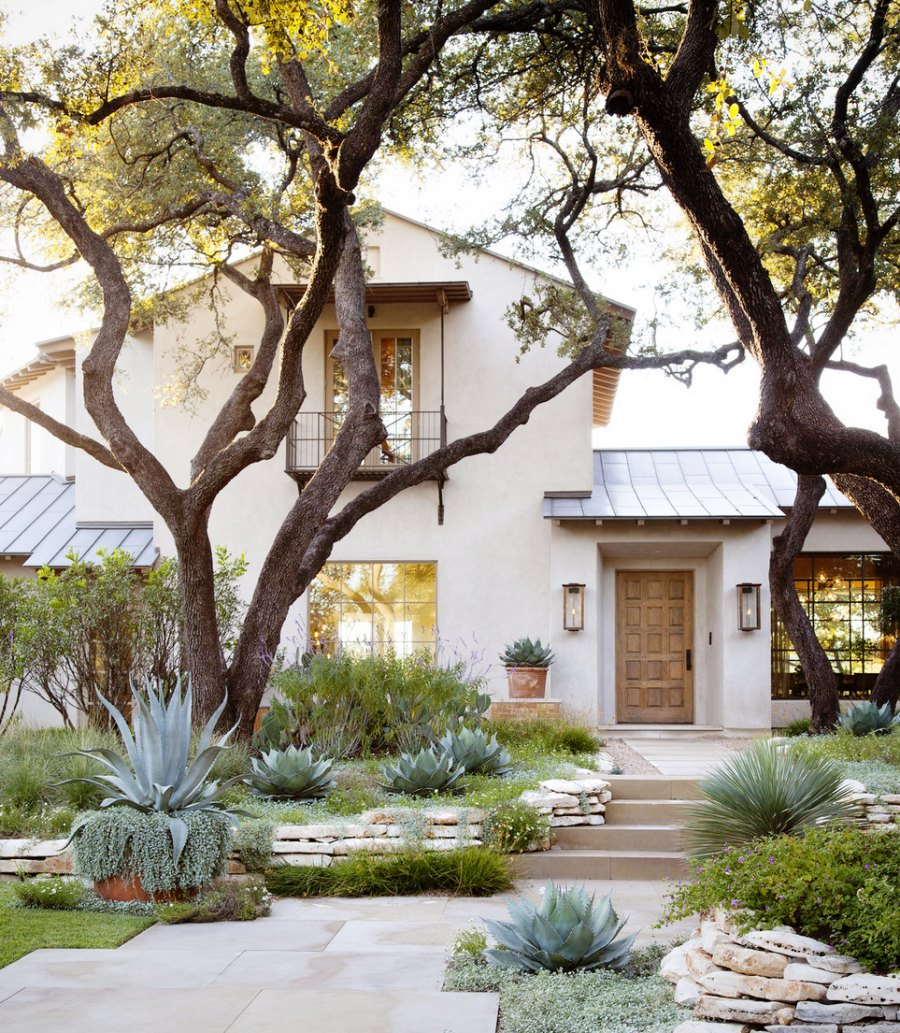 Beautiful stucco home with native landscaping