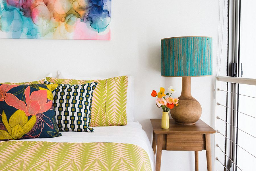 Bedding and pillow covers complement the wall art in the bedroom [Design: Nest Designs]