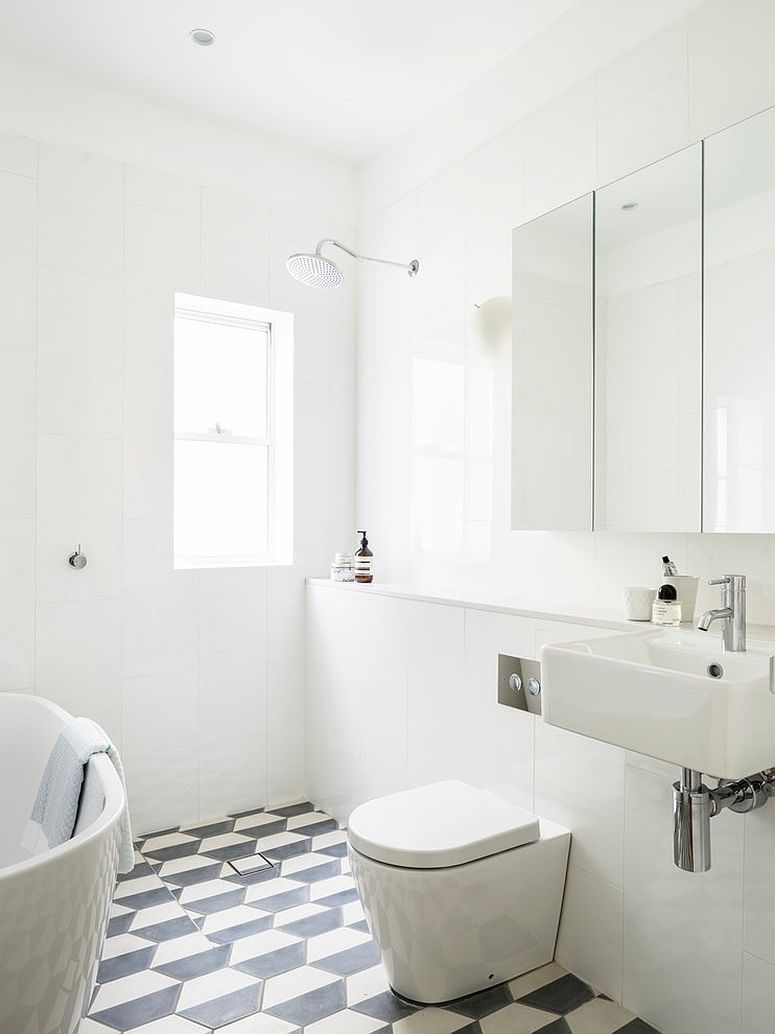 Black and white geometric floor tile for the beach style bathroom [Design: Decus Interiors]