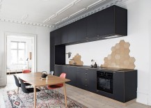 Black standalone unit in the kitchen steals the show [Design: Nicolaj Bo]