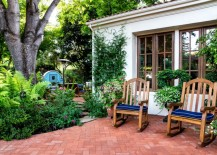 Brick herringbone patio with rocking chairs