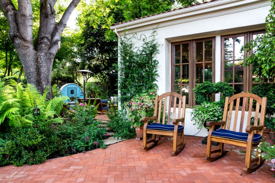 Brick herringbone patio with rocking chairs