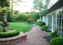 Brick patio beside a manicured lawn