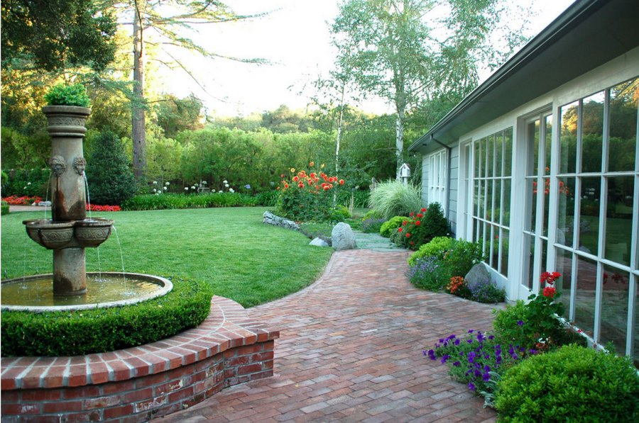 Brick patio beside a manicured lawn