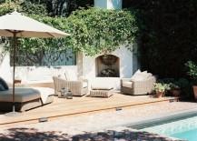 Brick patio beside a wooden deck