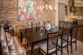 Brick wall offers a lovely backdrop for the colorful wall art piece