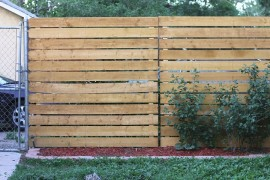 Cedar-panel privacy fence from Smile and Wave privacy fence Modern Privacy Fence Ideas for Your Outdoor Space Cedar panel privacy fence from Smile and Wave 270x180