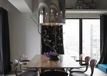 Cherner chairs at the dining room with a smart chandelier on top