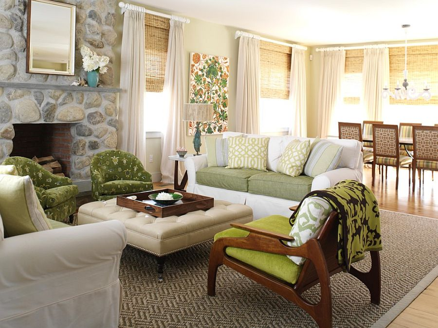 Chic beach style living room with a tufted ottoman as coffee table [Design: Tara Seawright]