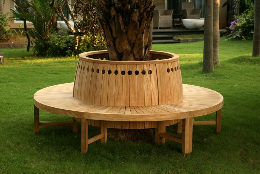 Round tree bench with circular cutouts  Tree Bench Ideas for Added Outdoor Seating Circular tree bench with circular cutouts