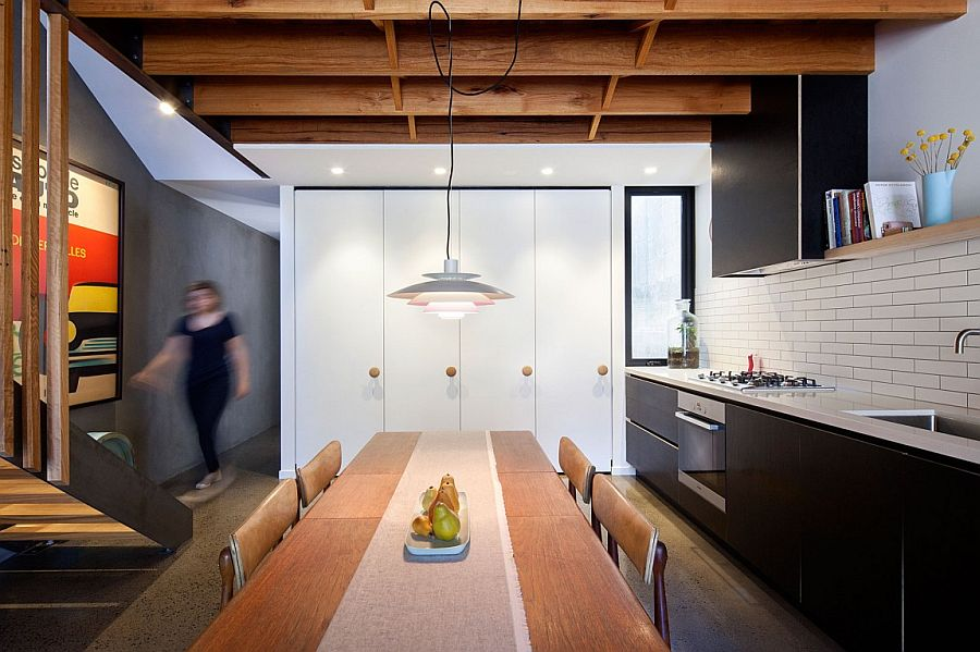 Classic pendant lighting above the dining with cool ambient illumination