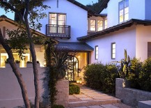 Classic stucco home with a modern walkway