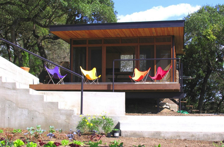 Colorful seating outside of a screened-in porch