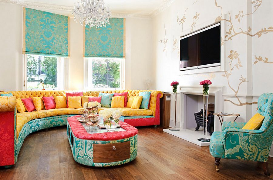 Colorful upholstered coffee table in Alice in wonderland tea room style living room [Design: Interior Desires UK]