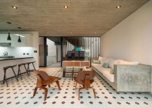 Concrete-couch-along-with-midcentury-decor-for-the-outdoor-sitting-area-217x155