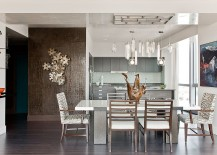 Contemporary dining room with metallic wall art over chocolate crocodile walls! [Design: Eric Roseff Designs]