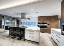 Contemporary-kitchen-in-white-with-black-breakfast-zone-and-wooden-shelves-217x155