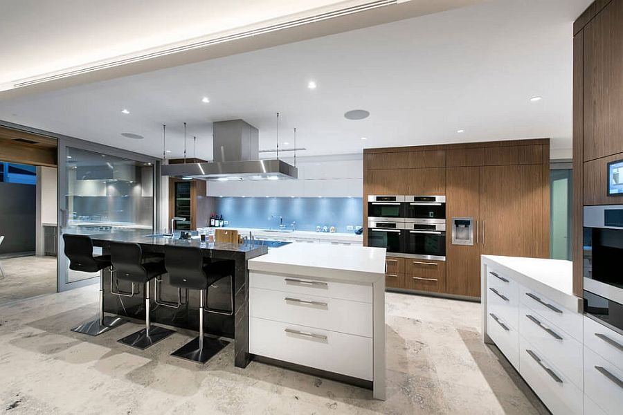 Contemporary kitchen in white with black breakfast zone and wooden shelves
