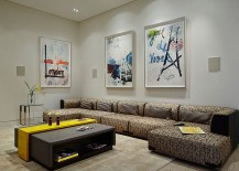 Contemporary living room uses wall art in a stylish fashion [Design: Alonso & Associates]